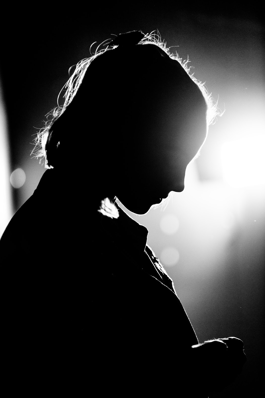 Woman backlit by stage lights