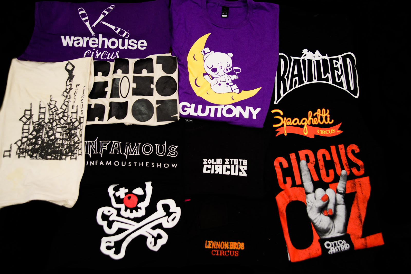 A collection of circus t-shirts is on display.