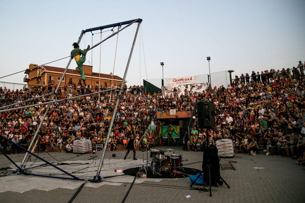 Acrobat on an aerial device at an outdoor show in Italy