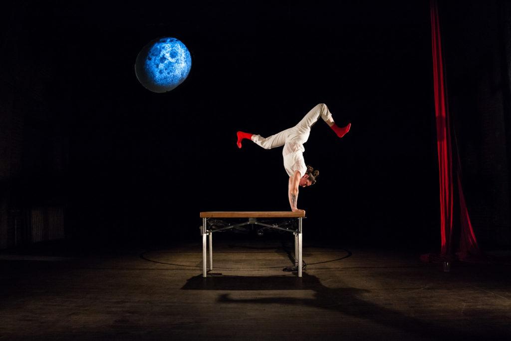 Nicole Burgio of XOXO Moongirl hand balancing