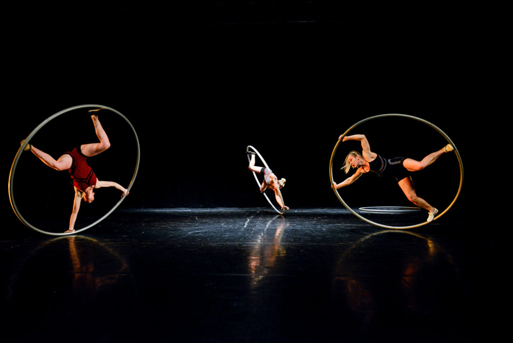 Three women performing on the Cur wheel