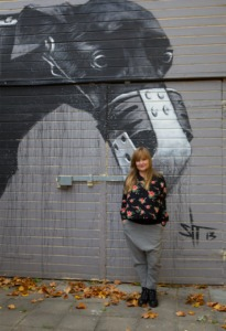 Woman in front of street art, Kiki Muukkonen, Artistic Director of Circus at Subtopia
