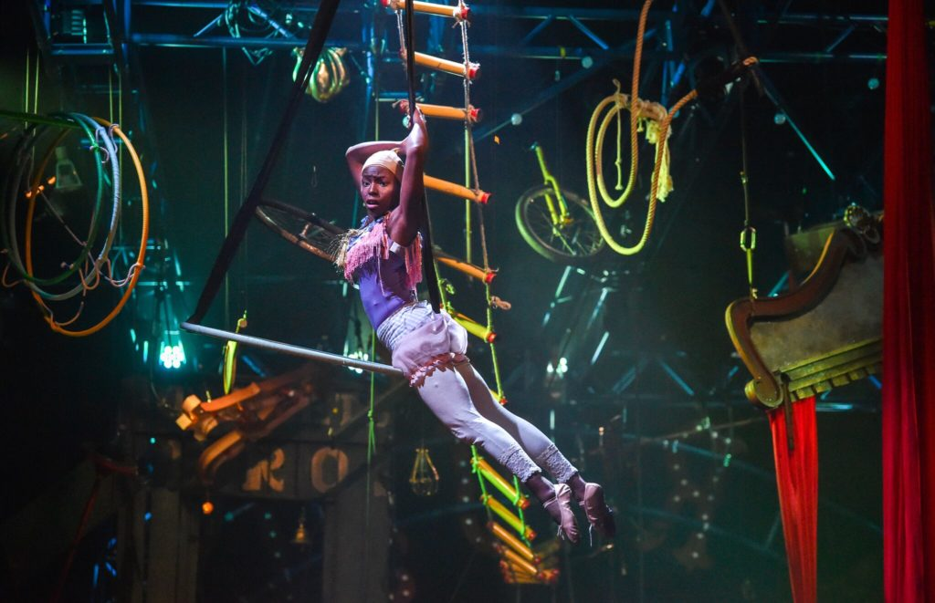Trapeze artist in The Exploded Circus