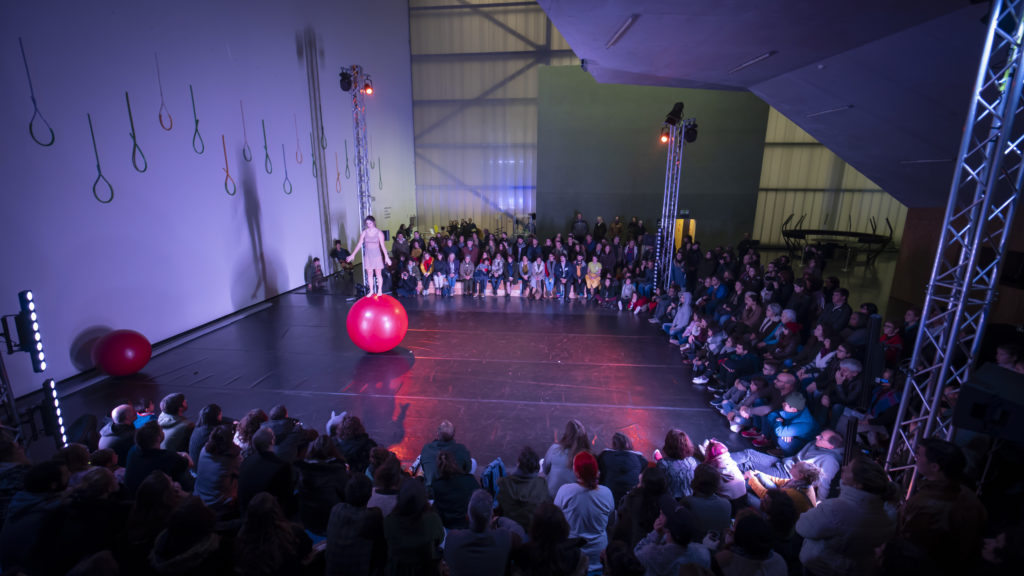 Performer on a red rolla bolla