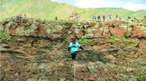 Mongolian Circus Artist Walks on 130-meter Long Rope over Chuluut River Canyon