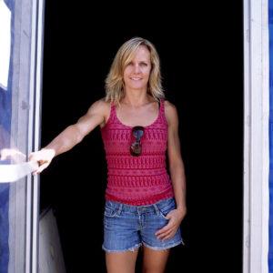 Stacy Clark standing in a doorway smiling