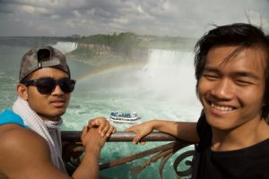 Sopha Nem and Dina Sok stand in from to Niagra Falls during one of their breaks from circus school