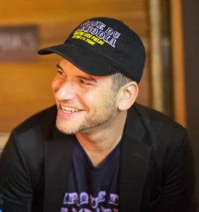 Documentary director wearing a baseball hat