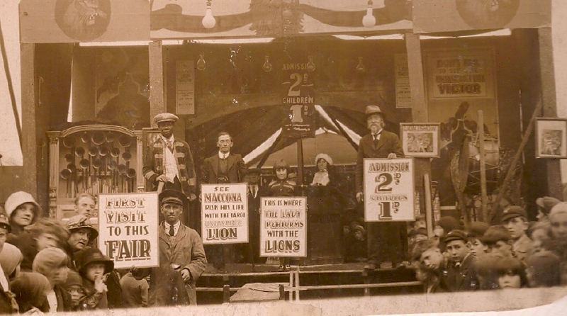 Albert May (on podium in uniform) the black lion tamer who performed as 'Maconna'.