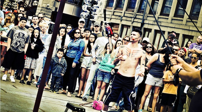 A street performer wows crowds by juggling