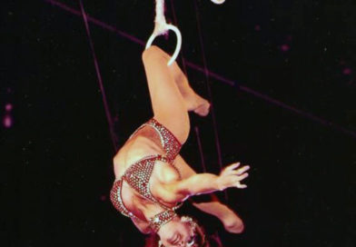 Dolly Jacobs performs a knee hang on the Roman Rings