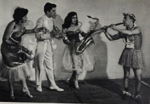 Four musicians happily put on a show, playing their instruments
