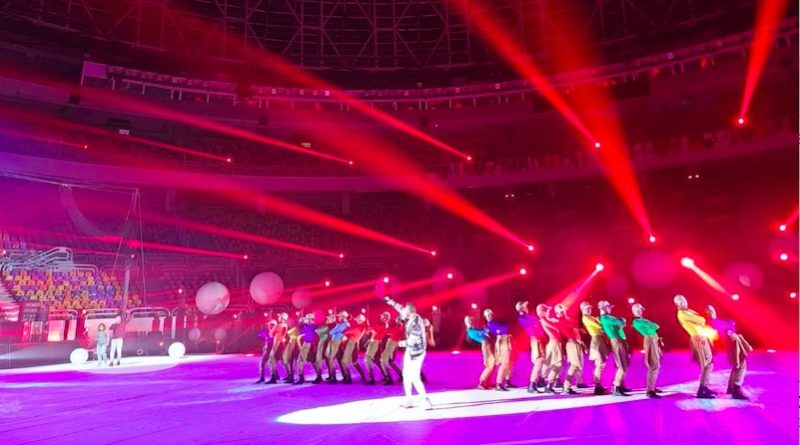 Cirque Éloize performers take the stage at the men's handball championship, with red and purple lights flooding the stage