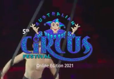 A man performs straps behind the Australian Circus Festival logo