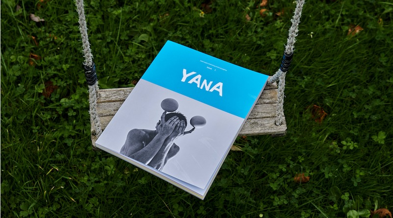 A YANA booklet lays on a swing