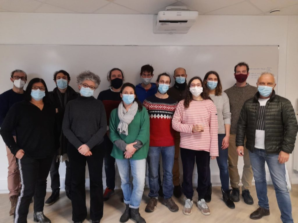 COSMIC program participants pose for a group photo, wearing masks