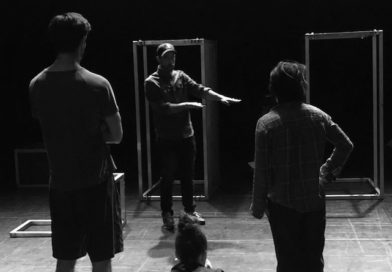 JP Cloutier stages with two other people, the three of them are cast in shadow on stage