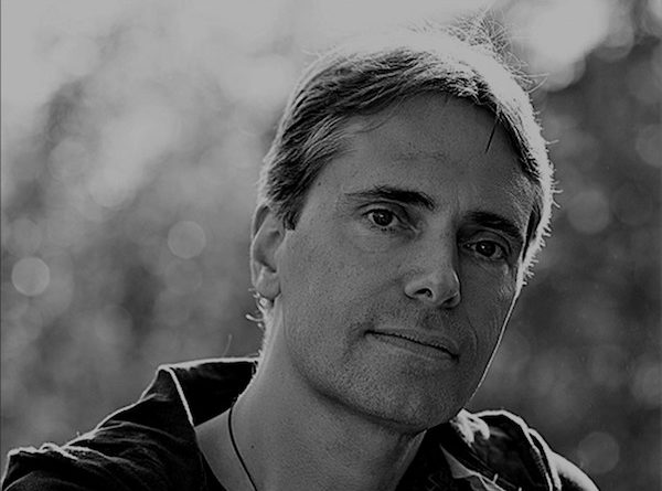 Matthew Jessner looks into the camera in black and white