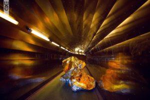 A tunnel of gold frames an artist