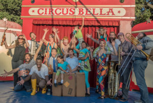 A group photo of circus artists outside Circus Bella