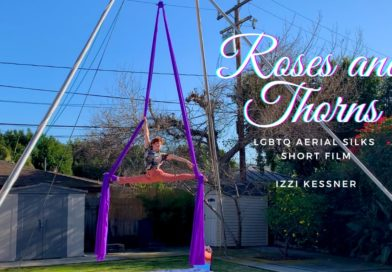 Izzi Kessner does a split on a purple pair of silks outside