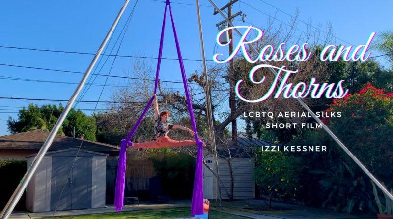 Izzi Kessner does a split on a purple pair of silks outside