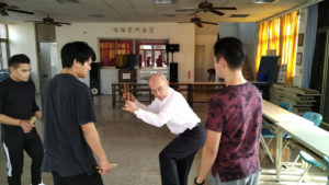 A group of Taiwanese acrobats stand in a lesson together