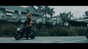 A screenshot of The Air on the Other Side shows two men on a motorcycle