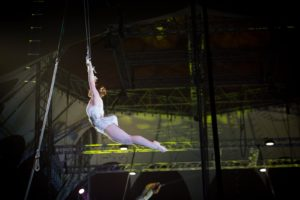 Emily Holt swinging on the flying trapeze