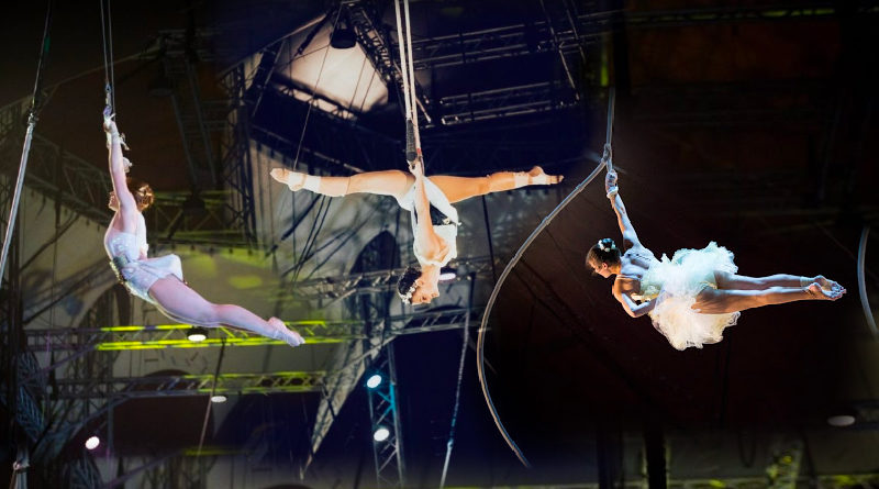 Emily, Lydia, and Kristen performing aerial side by side