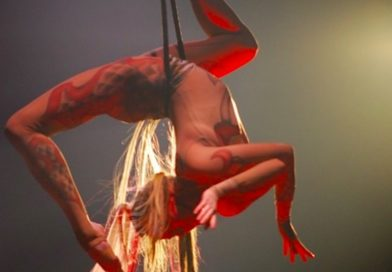 Mary hanging upside down in a stag position in the air