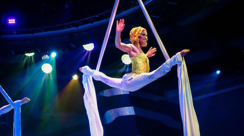 Silvia Dopazo performs a split balance on aerial silks