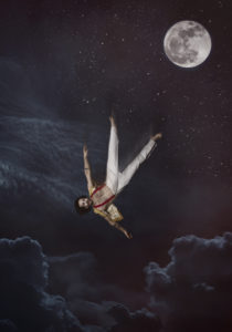 a circus performer in red suspenders and white pants floats in a night sky under the moon