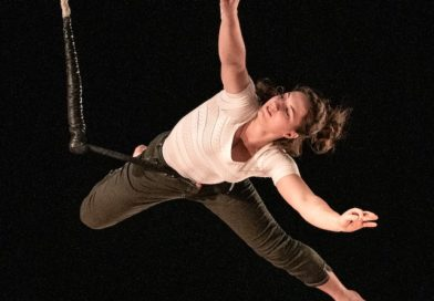 Constance Dansart hangs from a static trapeze