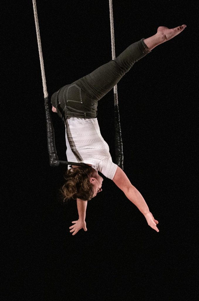Constance Dansart does a shoulder stand on a static trapeze