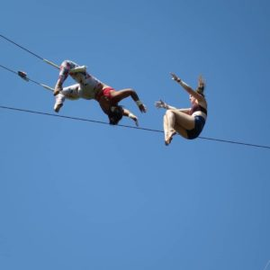 Two women doing flying trapeze together