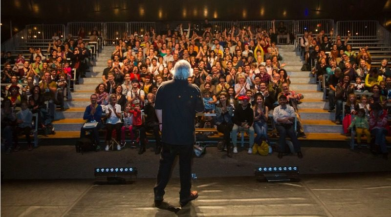 Donald Lehn faces an audience on stage