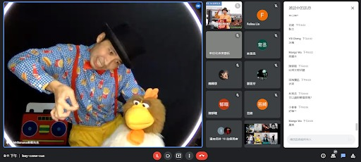Screen grab of an online streamed show depicting a man with a puppet