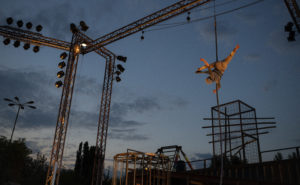 An aerialist on free ropes, suspended from the lighting truss of the WeLAND stage
