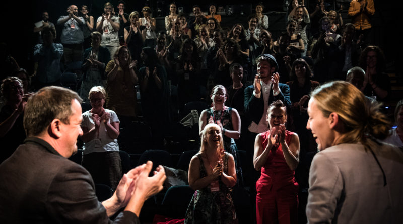 two presenters in the foreground are greeted with a standing ovation. Circus and its Other conference 2018 Prague