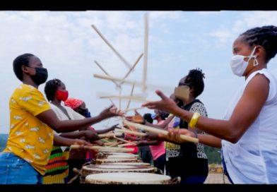 Ingoma Nyasha members juggling drumsticks