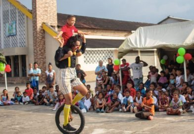 Clowns Without Border 2019 tour; Mexican clown Aaron Lars Uribe Rodriguez gives an Ecuadorian child a unicycle ride.
