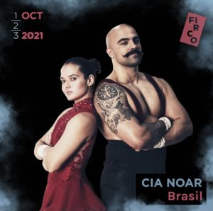 Olavo and Denise gaze intimidatingly into the camera, back to back with their arms crossed