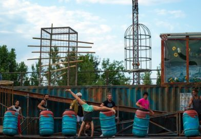7 acrobats perform on the industrial-esque stage of WeLAND
