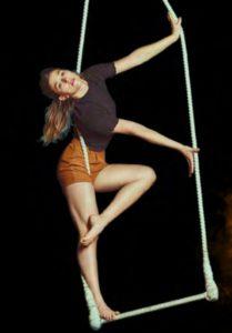 Serena Méndez performs a trick on the dance trapeze