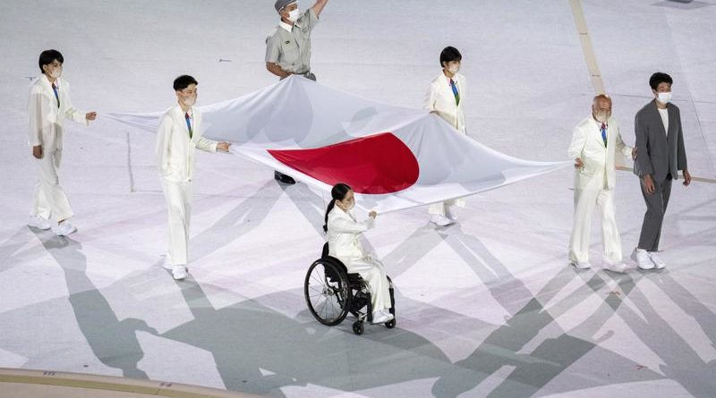 Six Japanese Paralympians carry the Japanese flag during opening ceremony