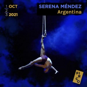Serena Méndez performs a single toe hang from the dance trapeze