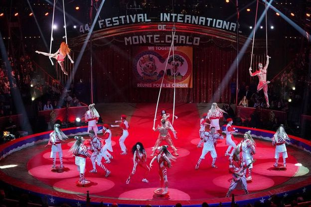 Red-clad performers onstage at Monte-Carlo International Circus Festival, 2020